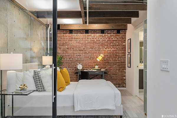 Photo #10 The downstairs en-suite bedroom with exposed red brick, timber, concrete...