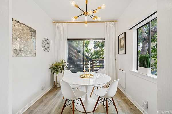 Photo #12 Naturally bright dining area has versatile options to be used as sunroom or office
