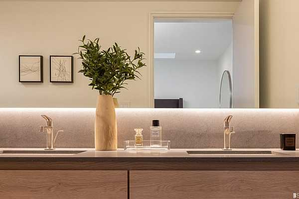 Photo #10 *Bathroom faucets by Hansgrohe *Lavatories by Toto *Oh La La bathroom Tiling *Back-lit Basaltina stone bathroom countertops *Pietra Italia tile flooring in secondary bathrooms  *Photo of model Residence No. 1 (not No. 3)