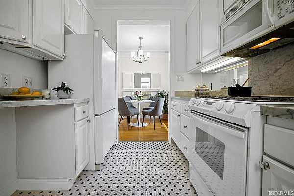 Photo #10 Spacious kitchen with modern appliances including a gas stove.