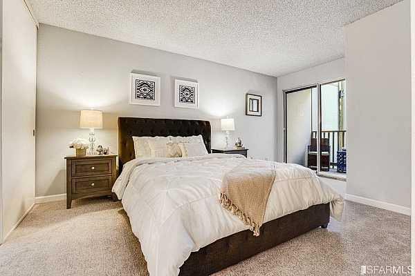 Photo #12 Your Bedroom with a private Patio Deck just for you!
